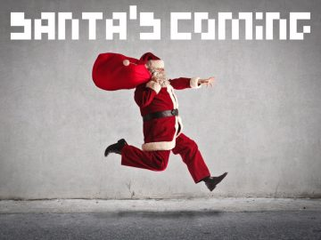 """Santa Claus is in mid-air as he runs down the sidewalk, pixelated letters overlaid read """"SANTA'S COMING"""""""